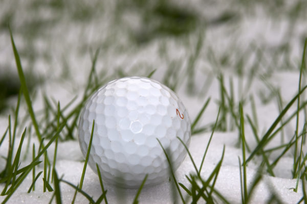 lone single golf ball in the snow